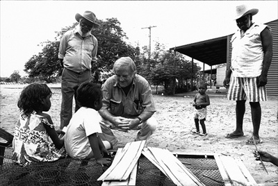 Fred Hollows take time out with local Indigenous children near Broome, Australia in the early 1990's. Photo: Stephen Ellison