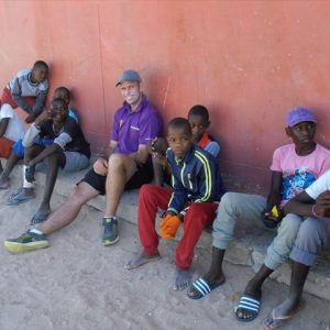Matt with kids at the JP Brand School in Namib NP