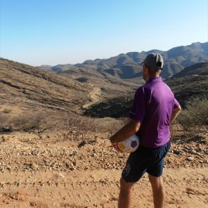 Photo of Matt looking back down the road he walked up the Gamsberg Pass