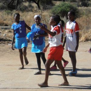 Photo of Aris Primary School - Girls continuing netball game with new donated ball