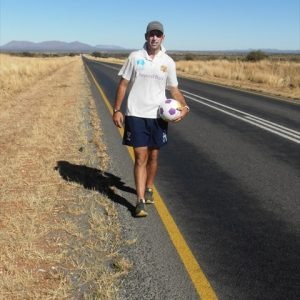 Photo of Day 14 - Matt back out on the long straight roads towards Botswana
