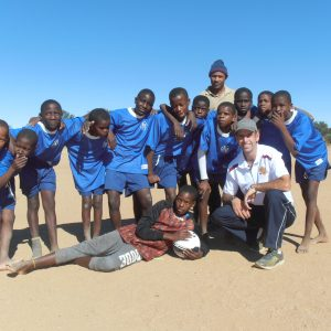 Photo of Aris Primary School - Matt with soccer team after donating balls