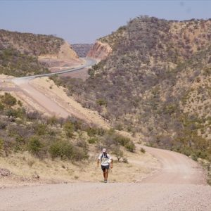 Day 35 - The road into Opuwo is quite hilly and dusty but I'm pushing on